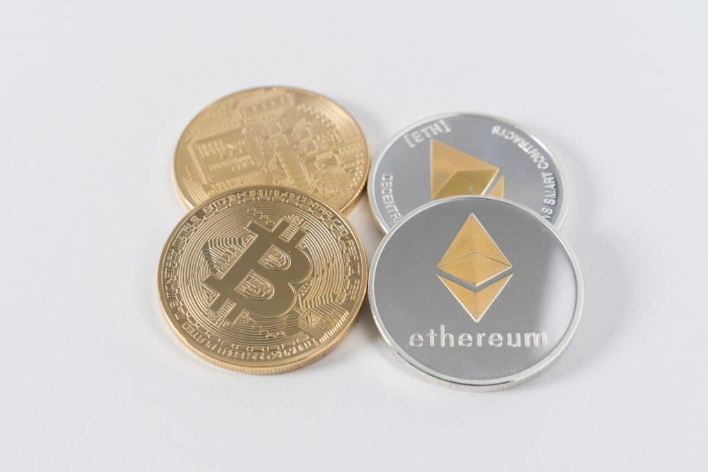 four coins, two golden bitcoins and two silver ethereum coins