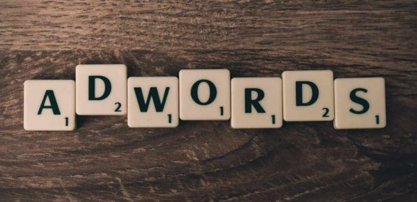 Scrabble letters forming the word adwords