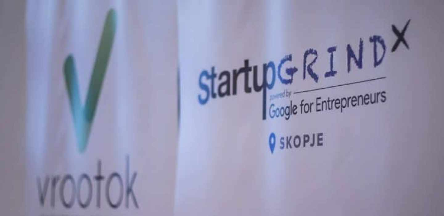 The Vrootok logo next to the Startup Grind logo